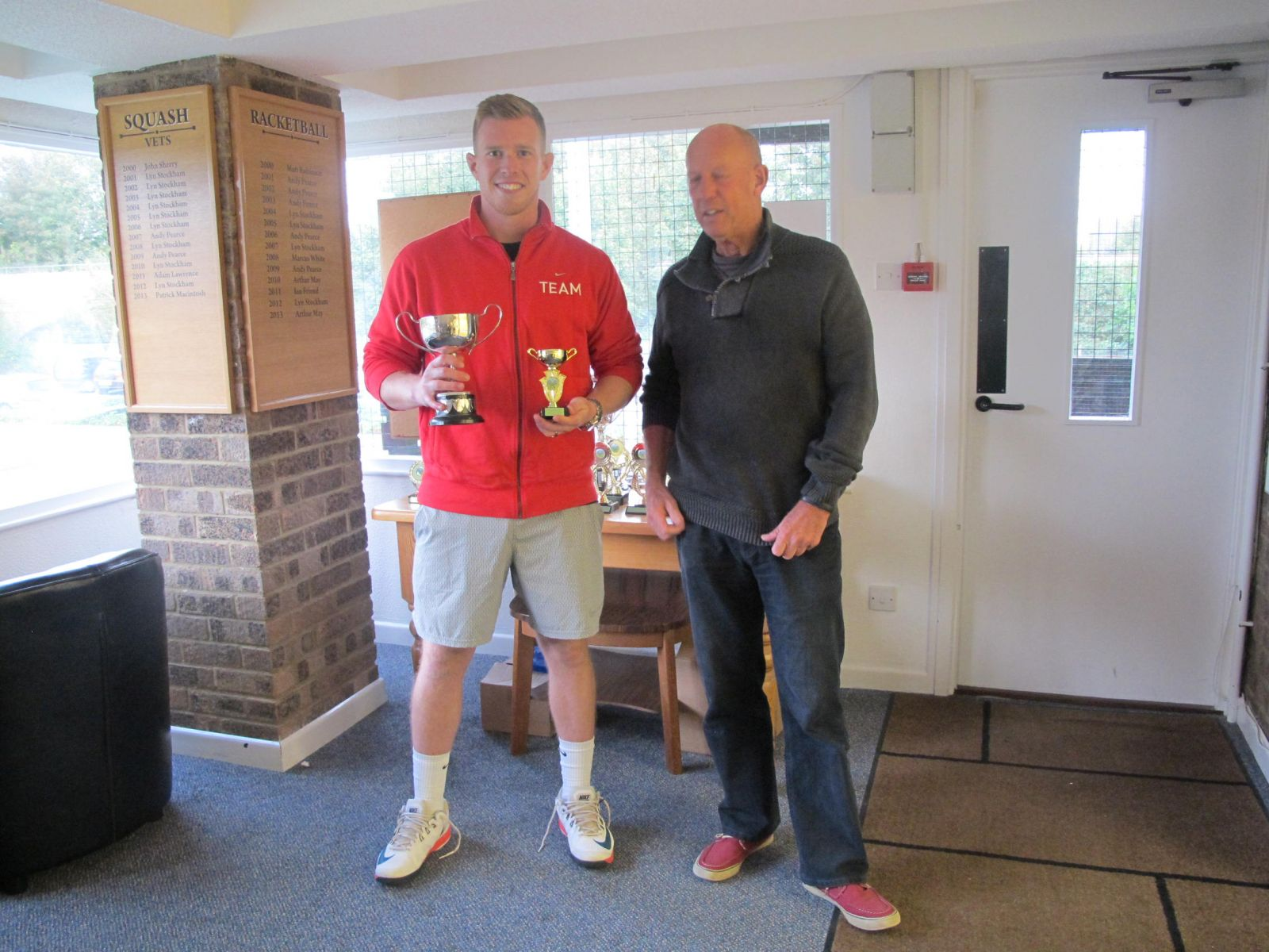 Men's Singles Champion Guy O'Neill receiving his trophy from Tennis Chairman Mike Henderson