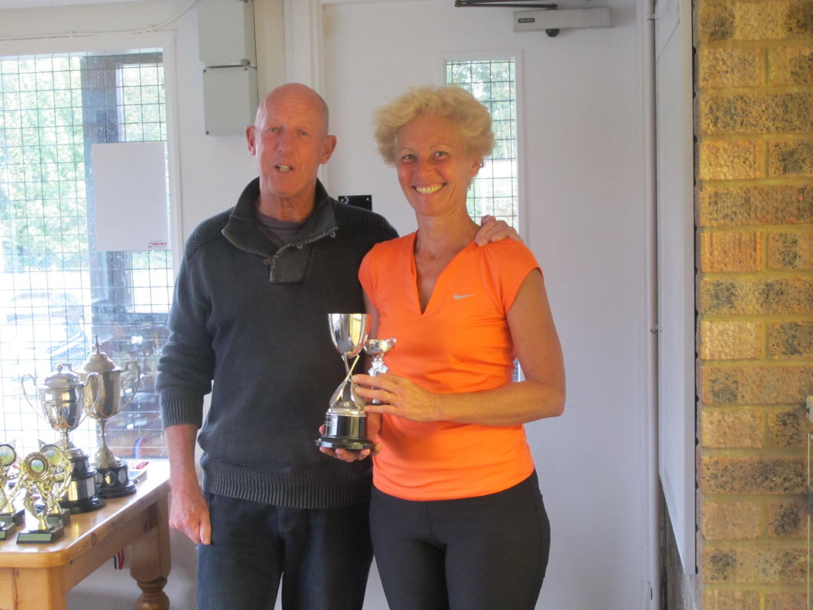 Ladies' Singles Champion Yvonne Henderson with Tennis Chairman Mike Henderson