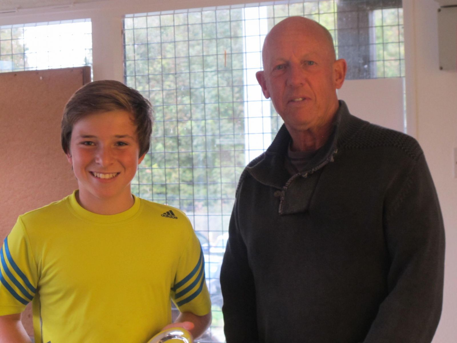 Joe Chambers receiving his Men's Singles Consolation Trophy from Tennis Chairman Mike Henderson