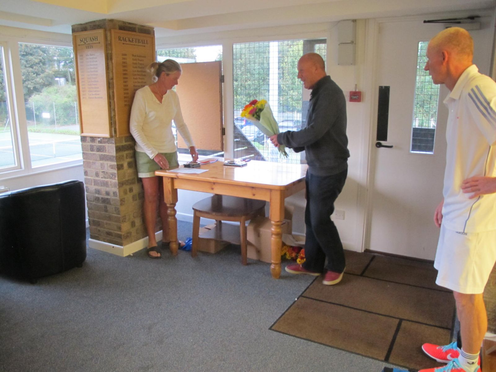 Tennis Chairman Mike Henderson presenting Sarah Skidmore, Tournament Organiser with a bouquet of flowers for all her hard work.